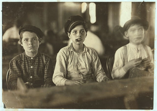 Young Cigarmakers in Englehardt & Co., Tampa, Fla. There boys looked under 14. Work was slack and youngsters were not being employed much. Labor told me in busy times many small boys and girls are employed. Youngsters all smoke (see 565). Witness Sara R. Hine. Location: Tampa, Florida.