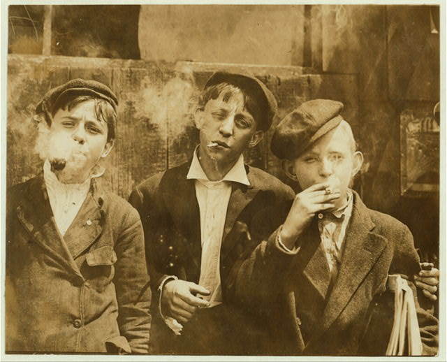 11:00 A. M . Monday, May 9th, 1910. Newsies at Skeeter's Branch, Jefferson near Franklin. They were all smoking. Location: St. Louis, Missouri.