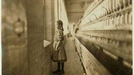 Rhodes Mfg. Co., Lincolnton, N.C. Spinner. A moment's glimpse of the outer world. Said she was 10 years old. Been working over a year. Location: Lincolnton, North Carolina.